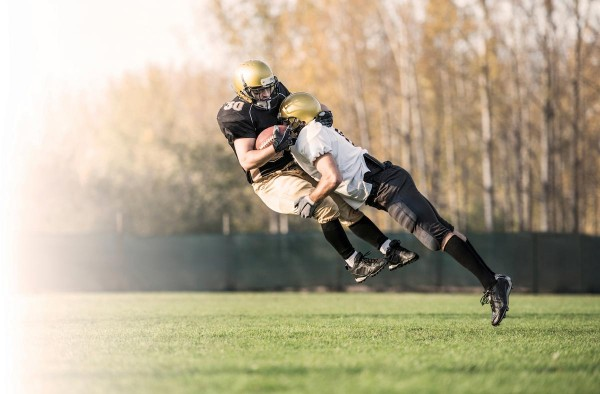 Image: Doctors now trying to ban high school football to protect teens from concussions