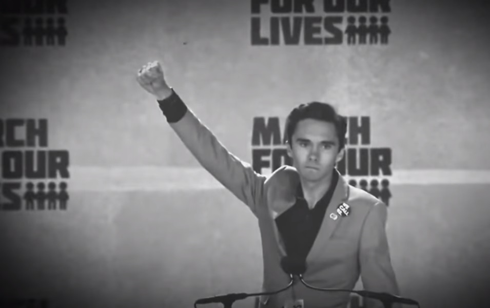 Image: Hypocrite David Hogg marches in protest against NRA alongside his own personal armed guards – watch at Brighteon.com