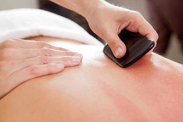 Image: Gua Sha therapy is highly beneficial for people with chronic lower back pain